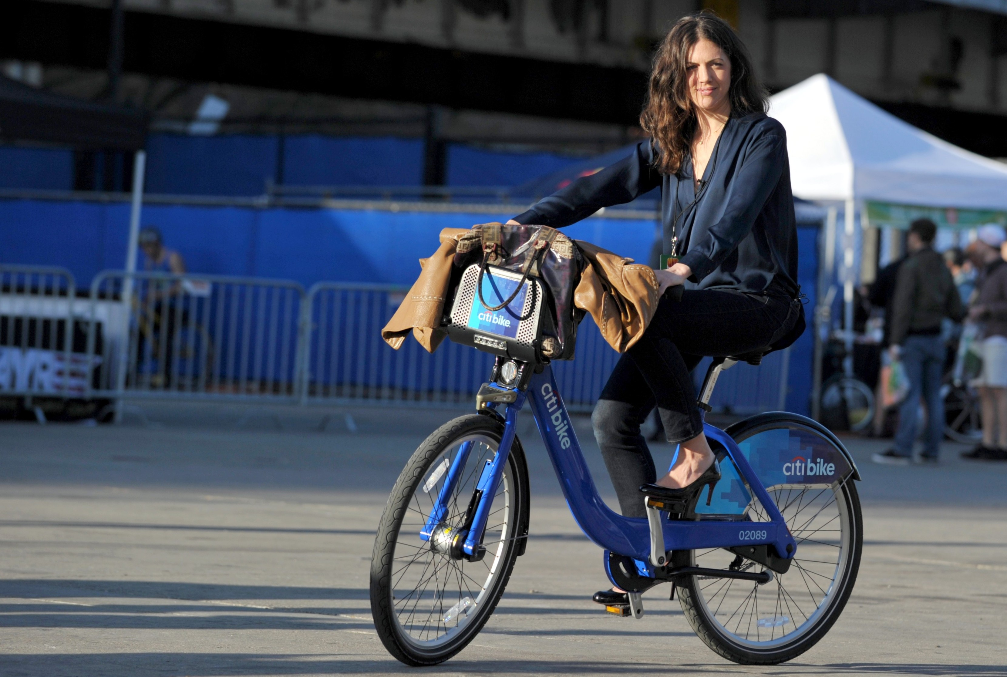 Christine Ribbecke tries out a Citibike model bicycle at Bike Expo, an exposition for cyclists, May 3, 2013 in New York. New Yorkers prepare for the launch of the Citibike bike sharing program, which will involve thousands of bicycles at hundreds of locations around the city tol be available to rent. AFP PHOTO/Stan HONDA        (Photo credit should read STAN HONDA/AFP/Getty Images)